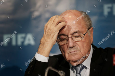 FIFA President Sepp Blatter attends a news conference in Marrakech, Morocco. Swiss attorney general's office confirms new raid, on FIFA, in ongoing investigations of Blatter and former FIFA secretary general Valcke. Both Blatter and Valcke deny wrongdoing