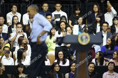 Barack Obama, Suboi U.S. President Barack Obama, foreground, listens as Vietnamese rapper Suboi, speaks at a town-hall style event for the Young Southeast Asian Leaders Initiative at the GEM Center in Ho Chi Minh City, Vietnam on . Obama is wrapping up a visit to Vietnam before traveling to Japan for the G-7 summit and a visit to Hiroshima