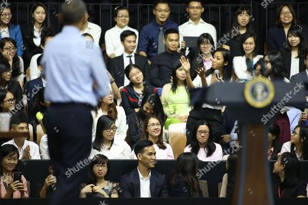 Barack Obama, Suboi Vietnamese rapper Suboi, right, claps her hands and raps for U.S. President Barack Obama at a town-hall style event for the Young Southeast Asian Leaders Initiative at the GEM Center in Ho Chi Minh City, Vietnam on . Obama is wrapping up a visit to Vietnam before traveling to Japan for the G-7 summit and a visit to Hiroshima