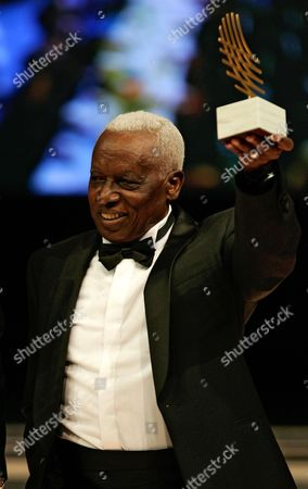 Ethopian coach Woldemeskel Kostre holds his coach of the year award during the 2006 World Athletics Gala in Monaco. Kostre, the Ethiopian distance running coach who trained greats like Haile Gebrselassie and Kenenisa Bekele and was renowned for his strict disciplinarian approach, has died. He was 69. The IAAF said Kostre died early, in Addis Ababa. The cause of death was not announced