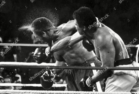 Showing George Foreman taking a right to the head from challenger Muhammad Ali in the seventh round in the match dubbed Rumble in the Jungle in Kinshasa, Zaire. Ali, the magnificent heavyweight champion whose fast fists and irrepressible personality transcended sports and captivated the world, has died according to a statement released by his family . He was 74
