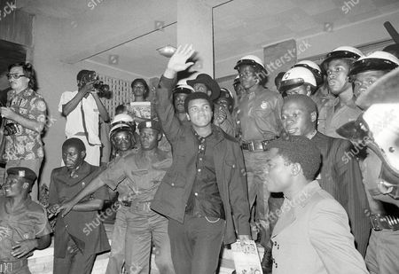 Heavyweight title challenger Muhammad Ali, surrounded by Zaire soldiers, waves to crowd upon his arrival in Kinshasa, Zaire. Ali is in Zaire for a fight against George Foreman. Ali, the magnificent heavyweight champion whose fast fists and irrepressible personality transcended sports and captivated the world, has died according to a statement released by his family . He was 74