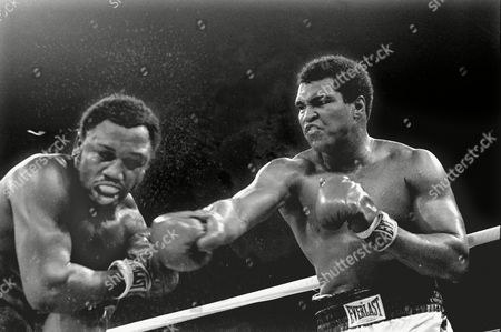 Spray flies from the head of challenger Joe Frazier as heavyweight champion Muhammad Ali connects with a right in the ninth round of their title fight in Manila, Philippines. Ali, the magnificent heavyweight champion whose fast fists and irrepressible personality transcended sports and captivated the world, has died according to a statement released by his family . He was 74
