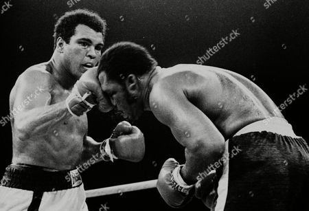 Muhammad Ali's throws a right at Joe Frazier in the 13th round in their title bout in Manila, Philippines. Ali, the magnificent heavyweight champion whose fast fists and irrepressible personality transcended sports and captivated the world, has died according to a statement released by his family . He was 74