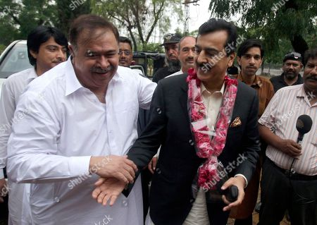 Pakistan's former Prime Minister Yusuf Raza Gilani, center, is greeted by supporters upon arrival at his residence in Islamabad, Pakistan, . A joint raid by U.S. and Afghan forces on Tuesday rescued his son who was held captive for three years by Islamic militants, officials said. Ali Haider Gilani was found during the raid near Afghanistan's eastern border with Pakistan, according to a spokesman for Afghan President Ashraf Ghani