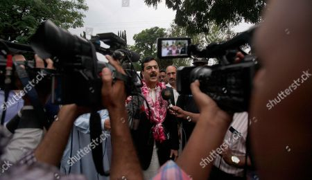 Pakistan's former Prime Minister Yusuf Raza Gilani talks to media outside his residence in Islamabad, Pakistan, . A joint raid by U.S. and Afghan forces on Tuesday rescued his son who was held captive for three years by Islamic militants, officials said. Ali Haider Gilani was found during the raid near Afghanistan's eastern border with Pakistan, according to a spokesman for Afghan President Ashraf Ghani