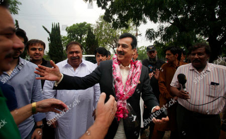 Pakistan's former Prime Minister Yusuf Raza Gilani, center, being greeted by supporters at outside his residence in Islamabad, Pakistan, . A joint raid by U.S. and Afghan forces on Tuesday rescued his son who was held captive for three years by Islamic militants, officials said. Ali Haider Gilani was found during the raid near Afghanistan's eastern border with Pakistan, according to a spokesman for Afghan President Ashraf Ghani
