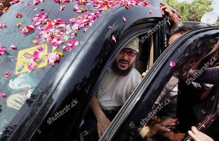 Stock Photo of Ali Haidar Gilani, son of former Pakistani Prime Minister Yusuf Raza Gilani disembarks from a vehicle upon arrival at his residence in Lahore, Pakistan, . Gilani, the son of a former Pakistani prime minister who was freed from kidnappers in a dramatic military rescue in Afghanistan arrived back home Wednesday and reunited with family, officials and family members said