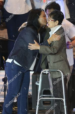 "Keiko Fujimori, Susana Higuchi Presidential candidate Keiko Fujimori, of the ""Fuerza Popular"" political party, left, kiss her mother Susana Higuchi during her closing presidential campaign rally in Villa el Salvador, in Lima, Peru, . The South American country is gearing up for a tight June 5th runoff between Keiko Fujimori, the daughter of jailed former President Alberto Fujimori, and former World Bank economist Pedro Kuczynski"