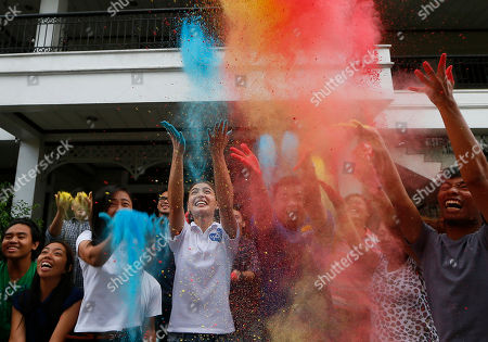 "Lovi Poe Actress Lovi Poe, fourth from left, the sister of Presidential candidate Grace Poe leads the symbolic throwing of colored powder as her sister is endorsed by ""Kabataan"" party-list group, a youth organization trying to campaign for a seating the Lower House, at suburban Quezon city northeast of Manila, Philippines. Poe is running second to front-running candidate Rodrigo Duterte in recent poll surveys leading to Monday's Presidential elections"