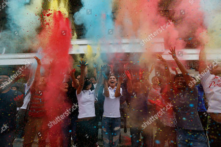 "Stock Image of Lovi Poe Actress Lovi Poe, center, the sister of Presidential candidate Grace Poe leads the symbolic throwing of colored powder as her sister is endorsed by ""Kabataan"" party-list group, a youth organization trying to campaign for a seating the Lower House, at suburban Quezon city northeast of Manila, Philippines. Poe is running second to front-running candidate Rodrigo Duterte in recent poll surveys leading to Monday's Presidential elections"