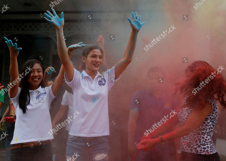 "Lovi Poe Actress Lovi Poe, center, the sister of Presidential candidate Grace Poe leads the symbolic throwing of colored powder as her sister is endorsed by ""Kabataan"" party-list group, a youth organization trying to campaign for a seating the Lower House, at suburban Quezon city northeast of Manila, Philippines. Poe is running second to front-running candidate Rodrigo Duterte in recent poll surveys leading to Monday's Presidential elections"