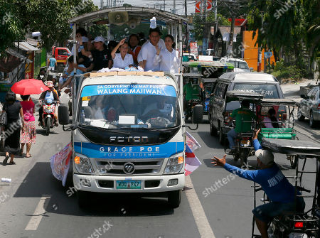 "Grace Poe, Heart Evangelista Escudero, Francis ""Chiz"" Escudero Philippines presidential candidate Sen. Grace Poe, center, and her running mate Sen. Francis ""Chiz"" Escudero, second from right, throw souvenir t-shirts and rubber wrist bands to residents as their motorcade makes the rounds of townships in Rizal province, east of Manila, Philippines . Poe is running second to front runner Rodrigo Duterte in recent poll surveys nine days to the May 9 presidential elections. At right is Escudero's wife Heart Evangelista Escudero"