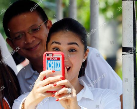 "Francis ""Chiz"" Escudero, Heart Evangelista Escudero Heart Evangelista Escudero, the wife of vice presidential candidate Sen. Francis ""Chiz"" Escudero, takes a selfie of themselves during a campaign sortie with presidential candidate Sen. Grace Poe at townships in Rizal province east of Manila, Philippines . Escudero is running third in recent poll surveys nine days to the May 9 presidential elections"