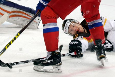 Stock Image of Christian Ehrhoff, Vadim Shipachyov Germany's Christian Ehrhoff, right, tries to block Russia's Vadim Shipachyov, center, during the Ice Hockey World Championships quarterfinal match between Russia and Germany, in Moscow, Russia, on