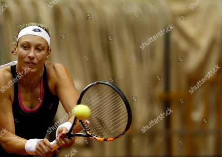 Yanina Wickmayer of Belgium returns the ball to Jovana Jaksic of Serbia during their Fed Cup World Group II play-off tennis match, in Belgrade, Serbia