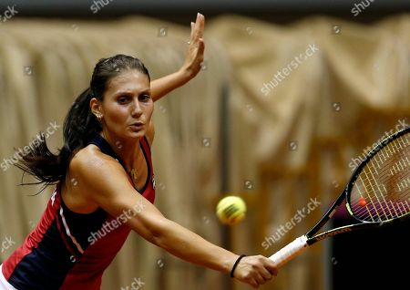 Stock Picture of Jovana Jaksic of Serbia returns the ball to Yanina Wickmayer of Belgium during their Fed Cup World Group II play-off tennis match, in Belgrade, Serbia