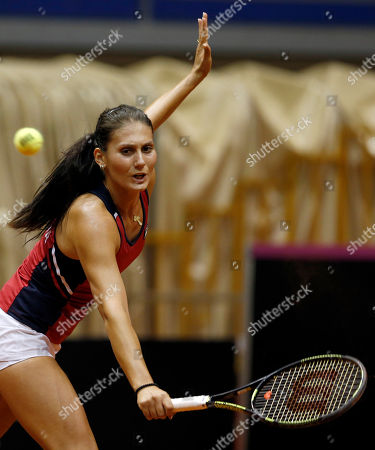 Stock Image of Jovana Jaksic of Serbia returns the ball to Yanina Wickmayer of Belgium during their Fed Cup World Group II play-off tennis match, in Belgrade, Serbia