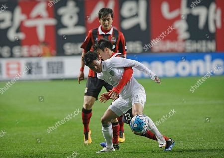 Theerathon Bunmathan, Go Yo-han Theerathon Bunmathan, left, of Thailand's Buriram United fights for the ball against Go Yo-han of South Korea's FC Seoul during their Group F soccer match in the AFC Champions League at Seoul World Cup Stadium in Seoul, South Korea