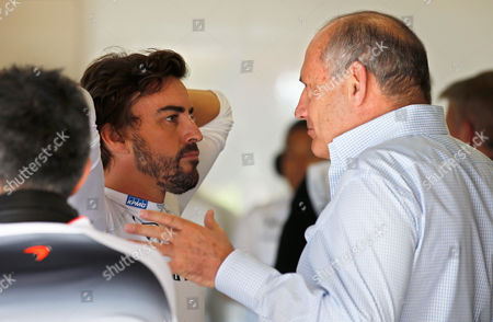 McLaren driver Fernando Alonso of Spain, left, and team founder Ron Dennis, right, stand in the team box, during the third practice session for Sunday's Spanish Formula One Grand Prix at the Barcelona Catalunya racetrack in Montmelo, just outside Barcelona, Spain