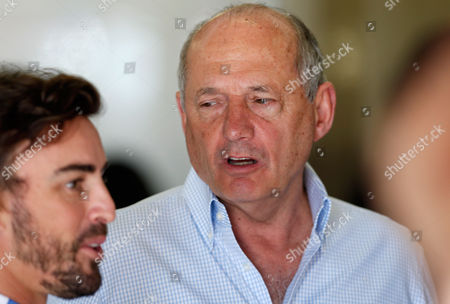 McLaren Formula One team founder Ron Dennis, right, looks at driver Fernando Alonso of Spain in the team box, during the third practice session for Sunday's Spanish Formula One Grand Prix at the Barcelona Catalunya racetrack in Montmelo, just outside Barcelona, Spain