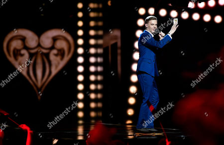 Estonia's Juri Pootsmann performs 'Play' during the first Eurovision Song Contest semifinal in Stockholm, Sweden
