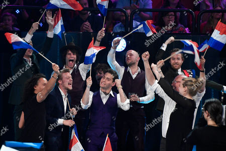 The Netherlands's Douwe Bob celebrates with his team after qualifying in the first Eurovision Song Contest semifinal in Stockholm, Sweden