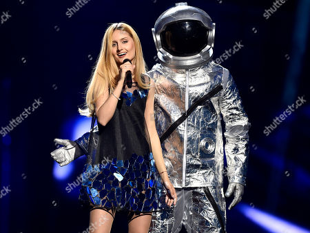 Moldova's Lidia Isac performs 'Falling Stars' during the first Eurovision Song Contest semifinal in Stockholm, Sweden
