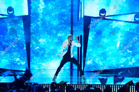 Lithuania's Donny Montell performs the song 'I've Been Waiting for This Night' during the second Eurovision Song Contest semifinal in Stockholm, Sweden