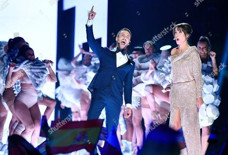 Hosts Mans Zelmerlow and Petra Mede react as they arrive for the Eurovision Song Contest final in Stockholm, Sweden
