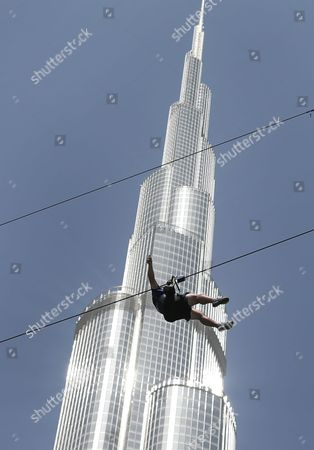 With the world's tallest tower, Burj Khalifa, in background, a man enjoys an urban zip line attraction in Dubai, United Arab Emirates. In the air travel hub of Dubai, there's a new way to fly: A zip line run by extreme sports company XDubai. XDubai, which began its operations in 2015, and is associated with Sheikh Hamdan bin Mohammed bin Rashid Al Maktoum, the crown prince of Dubai