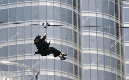 A woman enjoys an urban zip line attraction in Dubai, United Arab Emirates. In the air travel hub of Dubai, there's a new way to fly: A zip line run by extreme sports company XDubai. XDubai, which began its operations in 2015, and is associated with Sheikh Hamdan bin Mohammed bin Rashid Al Maktoum, the crown prince of Dubai