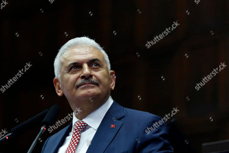 Binali Yildirim Binali Yildirim, who replaces the outgoing prime minister, Ahmet Davutoglu, addresses his lawmakers at the parliament in Ankara, Turkey, . President Recep Tayyip Erdogan has approved a new government formed by his trusted ally who has pledged to push through constitutional reforms that would expand the powers of the presidency