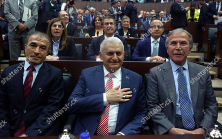 Binali Yildirim Binali Yildirim, center, who replaces the outgoing prime minister Ahmet Davutoglu, smiles to cheering lawmakers at the parliament in Ankara, Turkey, . President Recep Tayyip Erdogan has approved a new government formed by his trusted ally who has pledged to push through constitutional reforms that would expand the powers of the presidency