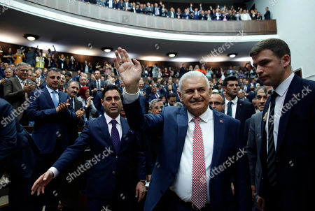 Binali Yildirim Binali Yildirim, who replaces the outgoing prime minister, Ahmet Davutoglu, waves before addressing his lawmakers at the parliament in Ankara, Turkey, . President Recep Tayyip Erdogan has approved a new government formed by his trusted ally who has pledged to push through constitutional reforms that would expand the powers of the presidency