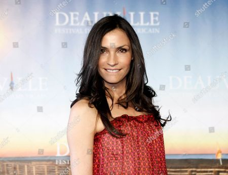 "Famke Janssen poses during a photocall for her film"" Bringing Up Bobby"", at the 37th American Film Festival in Deauville, Normandy, France. ""The Blacklist"" is branching out. NBC announced it has ordered a spin-off of the popular drama series starring James Spader as criminal-turned-informant Raymond ""Red"" Reddington. ""The Blacklist: Redemption"" will feature ""The Blacklist"" co-star Ryan Eggold, as well as guest stars Famke Janssen, Edi Gathegi and Tawny Cypress"