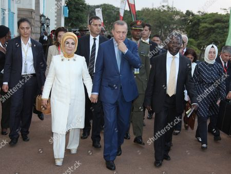 Uganda's Minister for Higher Education Tokodri Tagboa, second right, Turkish President, Recep Tayyip Erdogan, center, with his wife Hayrunnisa Gul, second left, leave after Erdogan was awarded a Makerere University honor doctorate in law, in Kampala, Uganda, . The European Union's reduction in funding for African Union troops in Somalia is a big mistake, Turkish President Recep Tayyip Erdogan said Wednesday during a visit to Uganda. Erdogan is two days state visit to Uganda