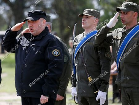 Oleksandr Turchynov Secretary of Ukraine's National Security and Defence Council Oleksandr Turchynov, left, salutes during a ceremony marking the first anniversary of the creation of a rapid reaction unit of Ukraine's National Guard, in the village of Stare, some 80 km east of Kiev, Ukraine