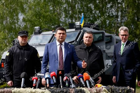 "Oleksandr Turchynov, Volodymyr Groysman, Arsen Avakov, Jeffrey Payette Secretary of the National Security and Defence Council of Ukraine Oleksandr Turchynov, left, Ukraine's Prime Minister Volodymyr Groysman, center left, Ukrainian Interior Minister Arsen Avakov, center right, and US Ambassador to Ukraine Jeffrey Payette, right, speak with the media after the graduation ceremony of special forces personnel ""Kord"" near Kiev, Ukraine"