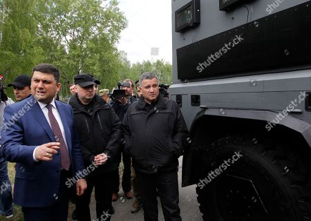 "Volodymyr Groysman, Oleksandr Turchynov, Arsen Avakov Ukraine's Prime Minister Volodymyr Groysman, left, Secretary of the National Security and Defence Council of Ukraine Oleksandr Turchynov, center, and Ukrainian Interior Minister Arsen Avakov inspect military armoured personnel carriers after the graduation ceremony of special forces personnel ""Kord"" near Kiev, Ukraine"