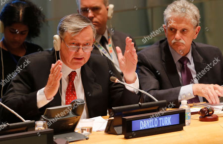General Assembly President Mogens Lykketoft, right, listens as former Slovenian President Danilo Turk, left, address questions from the 193-member General Assembly about his candidacy for U.N. Secretary General, at U.N. headquarters. The United Nations is taking a historic step to open up the usually secret process of selecting the next secretary-general, giving all countries the chance to question candidates on issues
