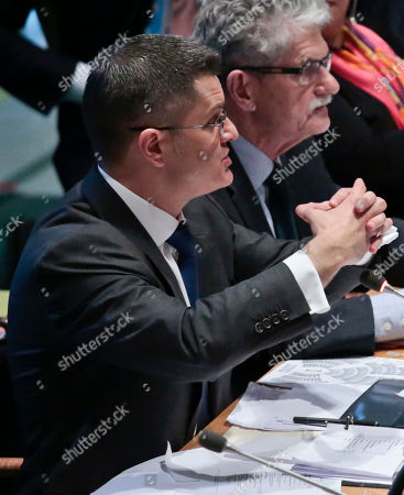 Former Serbian foreign minister Vuk Jeremic, left, is seated next to General Assembly President Mogens Lykketoft, right, as he address questions from the 193-member General Assembly about his candidacy for U.N. Secretary General, at U.N. headquarters. The United Nations is taking a historic step to open up the usually secret process of selecting the next secretary-general, giving all countries the chance to question candidates on issues
