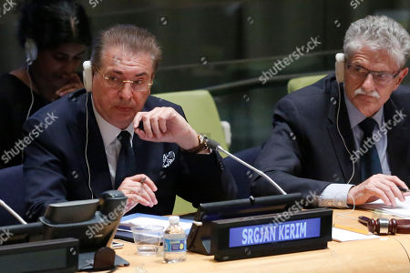 Former Macedonian Foreign Minister Srgjan Kerim, left, is seated next to General Assembly President Mogens Lykketoft, right, while listening to questions from U.N. General Assembly members about his candidacy for U.N. Secretary General, at U.N. headquarters. The United Nations is taking a historic step to open up the usually secret process of selecting the next secretary-general, giving all countries the chance to question candidates on issues