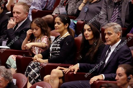 From right, actor George Clooney, his wife Amal, Actress Salma Hayek, with her daughter Valentina Paloma Pinault and her husband Francois-Henri Pinault, attend a meeting with the Scholas Occurrentes, an educational organization founded by Pope Francis, at the Vatican