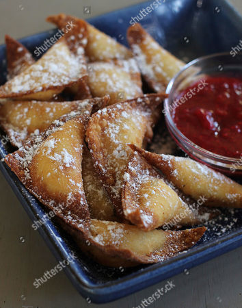 PHOTO; FOR USE WITH AP LIFESTYLES This photo shows fried sweet cheese and almond dumplings in Concord, N.H. This dish is from a recipe by Sara Moulton
