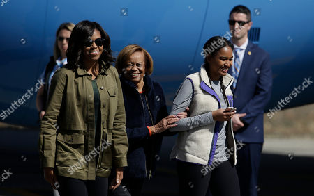 First lady Michelle Obama, right, her mother Marian Robinson, center, and daughter Sasha arrive at Bariloche, Argentina, . Obama is closing his two-day visit to Argentina by spending the afternoon with his family in Bariloche, a picturesque city in southern Argentina, before departing for Washington