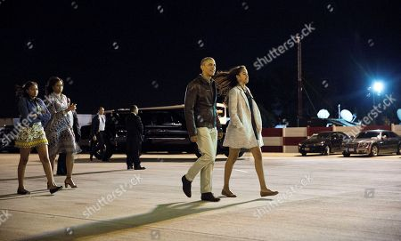 Barack Obama, Michelle Obama, Malia Obama, Sasha Obama, Marian Robinson President Barack Obama, with his daughter, Malia, are followed by first lady Michelle Obama, and daughter, Sasha, walking across the tarmac before boarding Air Force One at Ezeiza Airport in Buenos Aires, Argentina, . Earlier in the day, the first family visited Bariloche, Argentina, before departing for a return flight to Washington