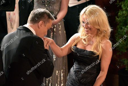 Alfons Haider, Pamela Anderson Broadcaster ORF moderator Alfons Haider, left, kisses the hand of U.S actress Pamela Anderson, during the traditional Opera Ball in Vienna, Austria, . The Opera Ball is one of the most privileged events in the Austrian social calendar, attracting invited local guests along with luminaries and international dignitaries