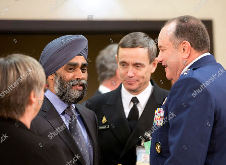 Stock Image of Canadian Defense Minister Harjit Singh Sajjan, second left, speaks with Supreme Allied Commander Europe, Gen. Philip Breedlove, right, during a meeting of the North Atlantic Council at NATO headquarters in Brussels on . NATO defense ministers convene a two-day meeting to discuss current defense issues and whether the Alliance should take a more direct role in dealing with its gravest migrant crisis since WWII