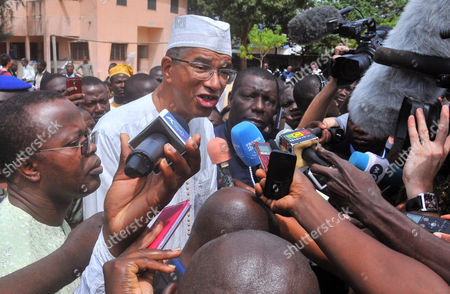 """Lionel Zinsou Taken, Presidential candidate, Benin prime minister Lionel Zinsou, second left, speaks to the media after casting his ballot during the election, in Cotonou, Benin. Benin is holding a presidential runoff vote, Sunday, March 20, 2016, that pits the prime minister against a cotton magnate who was once accused of trying to poison the current president. Lionel Zinsou, a French-born investment banker who was named prime minister last year, earned 28 percent of the March 6 vote. Patrice Talon, known locally as """"the king of cotton,"""" came in second with 24 percent but has received support during the runoff campaign from other top finishers"""